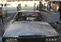 Burned out car in Iraq