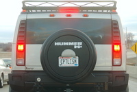 hummer with capitalism plates