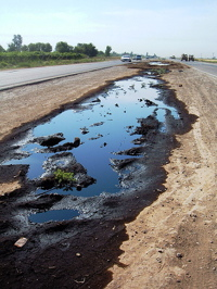 Oil spill on a highway median in Iraq
