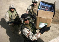 US Soldiers unloading prayer rugs in Iraq