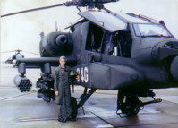 standing next to Apache Longbow