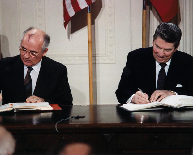 Reagan and Gorbachev, signing