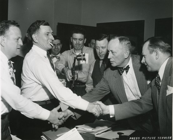 UAW negotiators with Walter Reuther (center) arrive at an agreement with General Motors.